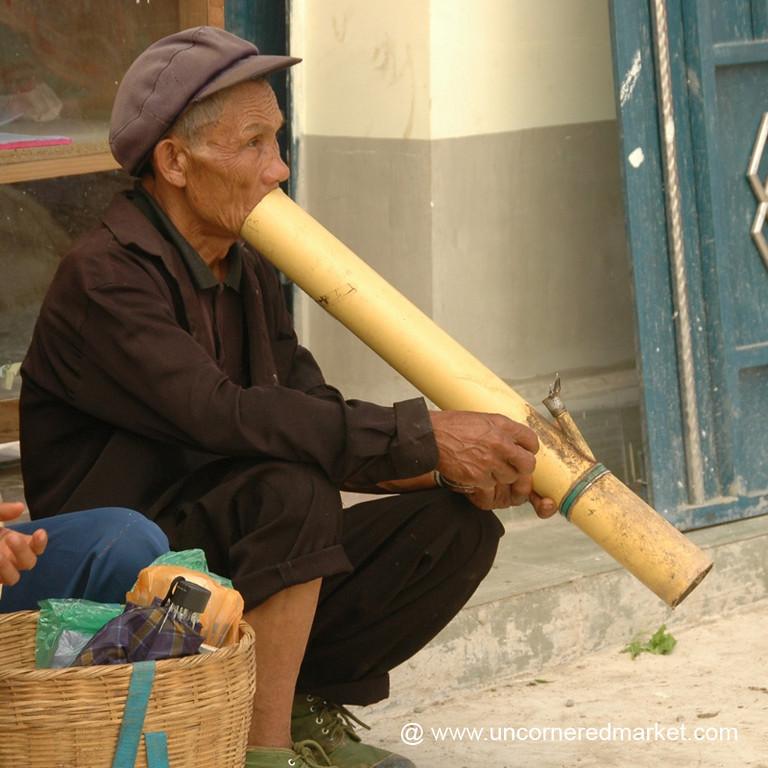 Hani Man Smoking a Pipe - Yuanyang, China