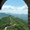 The Great Wall of China in West Simatai through an archway in a guard tower.