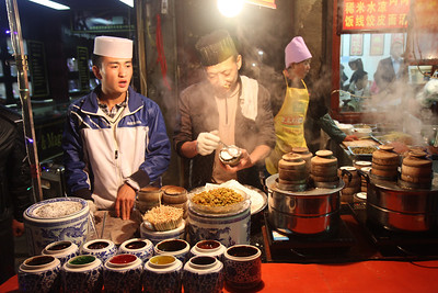 Uyghur men at the night market, Xian.