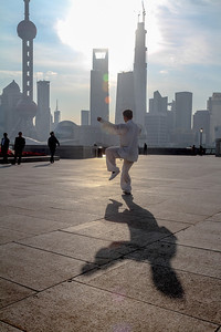 Tai chi at sunrise on the Bund. Shanghai, China.