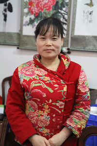 Chinese woman in traditional dress.
