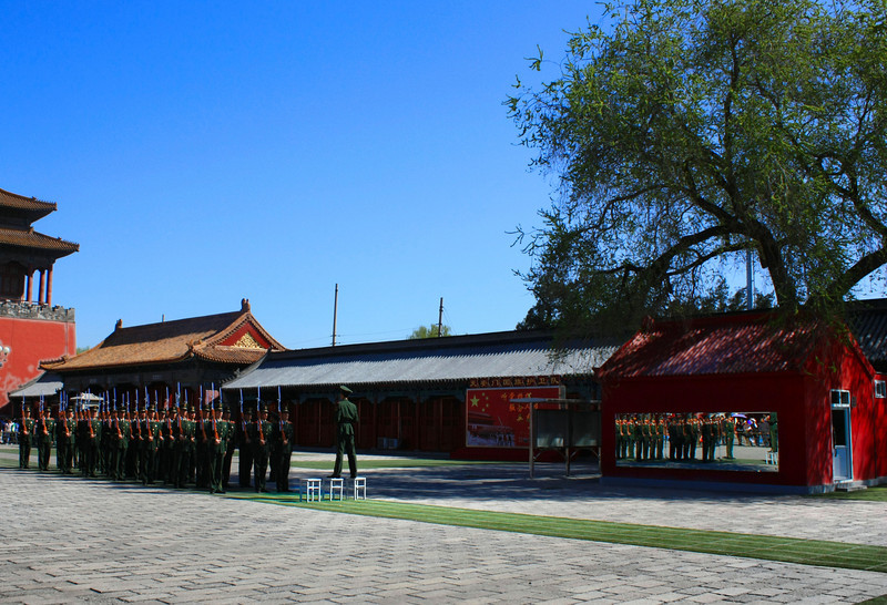 Reflections of Communism:  Chinese soldiers are inspected in the Forbidden City and their reflection can be seen in a mirror.