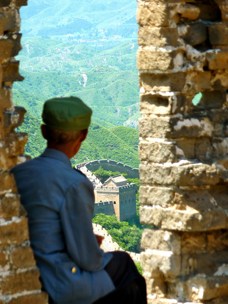 An old Chinese man taking in the view at the Jinshanling section of the Great Wall of China.