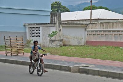 Local kids riding a bike in Dili, East Timor