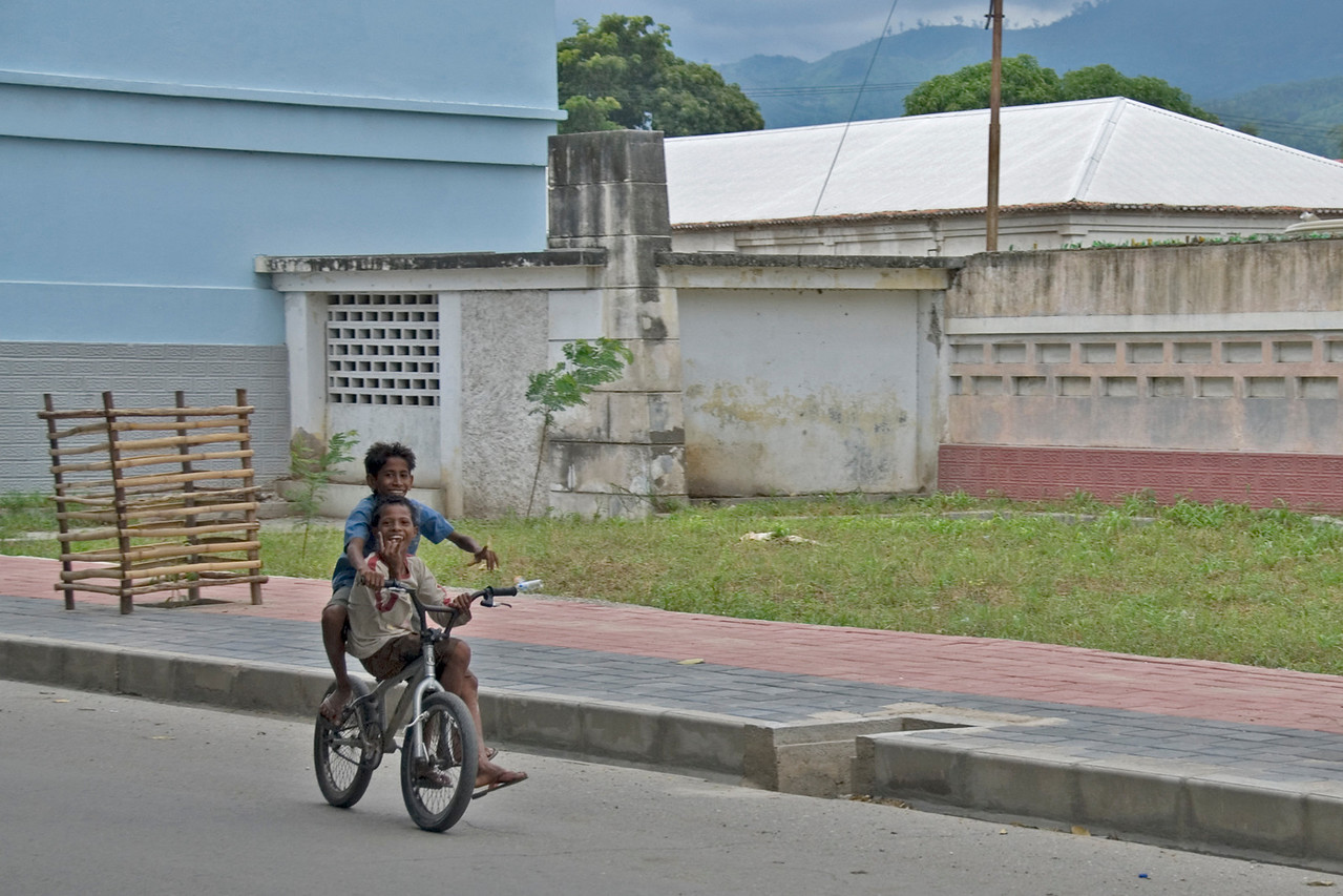 Local kids riding a bike in Dili, East Timor