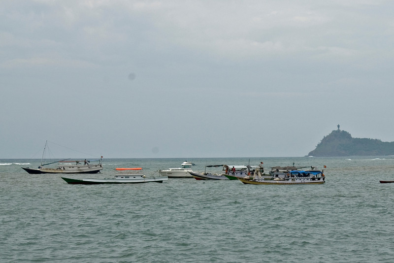 Boats in a calm sea at the Dili Harbor in East Timor