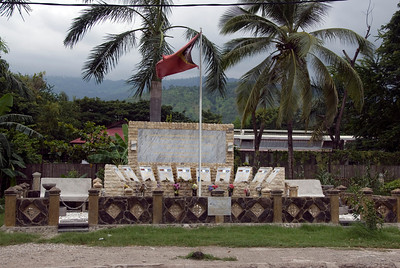 East Timor flag waving on top of police memorial in Dili, East Timor