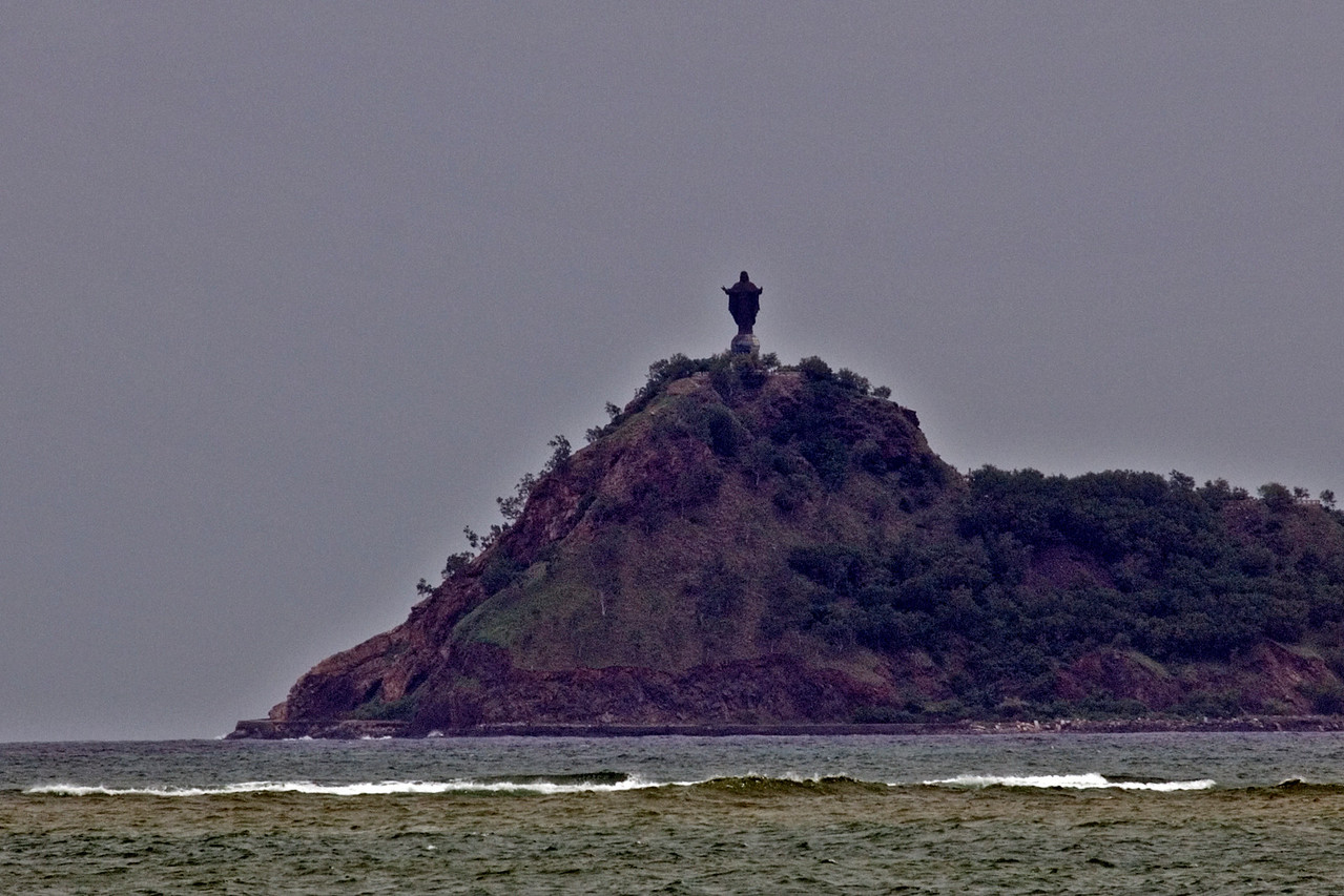 The Jesus Statue overlooking the sea from atop a mountain in Dili, East Timor