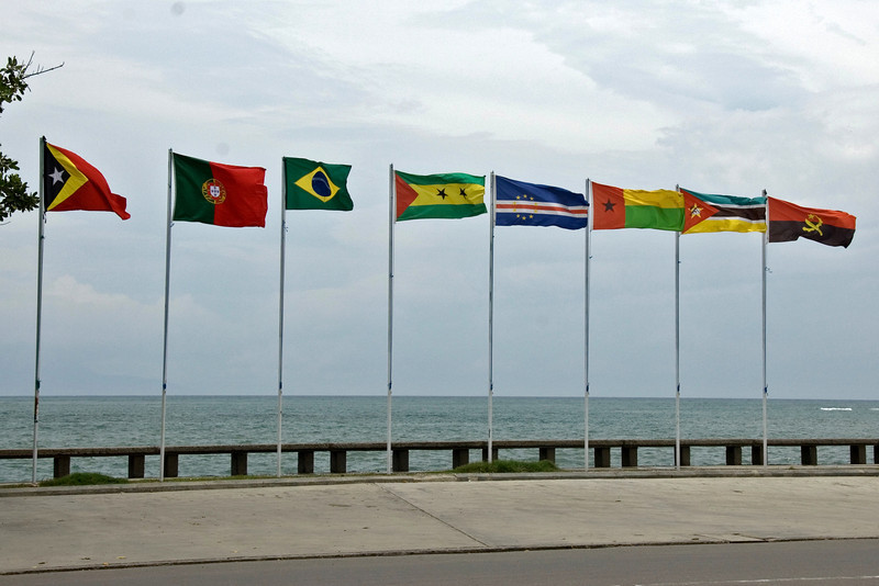 Row of flags waving along the Dili Harbor in East Timor