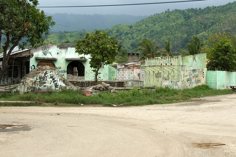 Graffiti on the walls of an old, destructed building along a street in Dili, East Timor