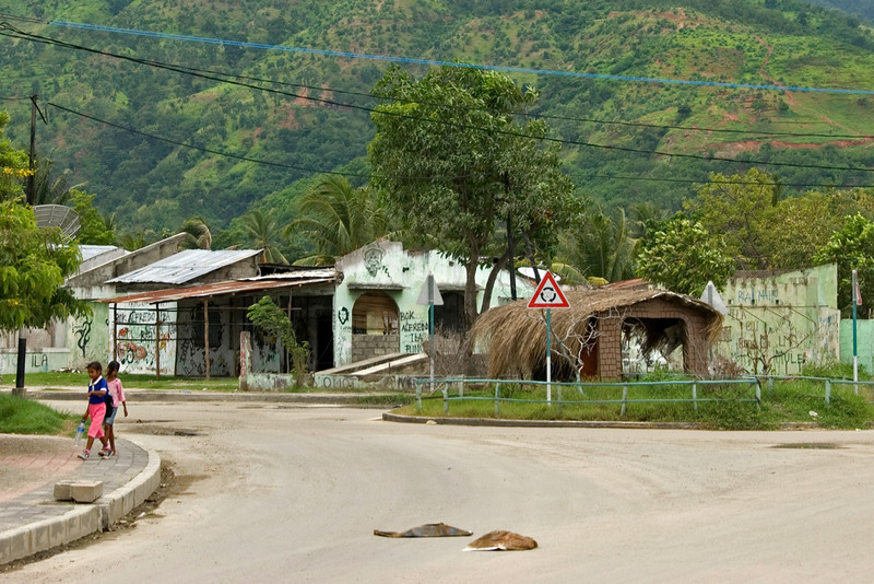 Shot of a street in Dili, East Timor with large mountain on the background.