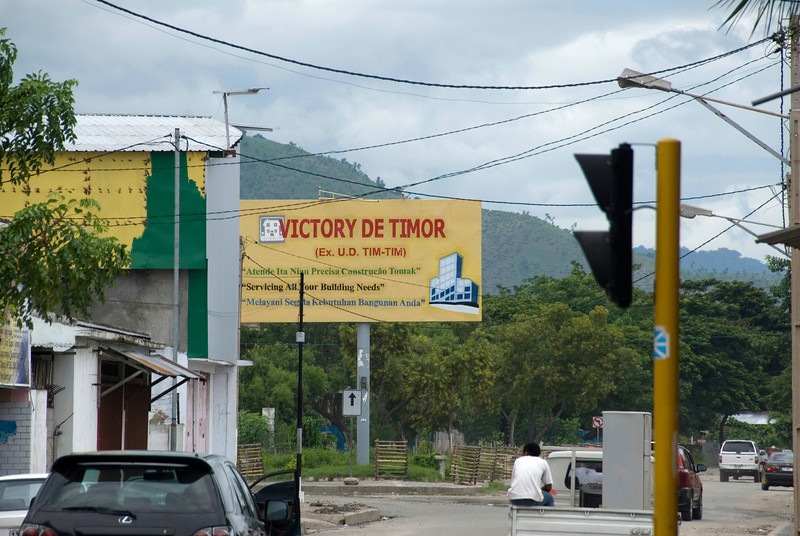 Signs and motorists at a street in Dili, East Timor