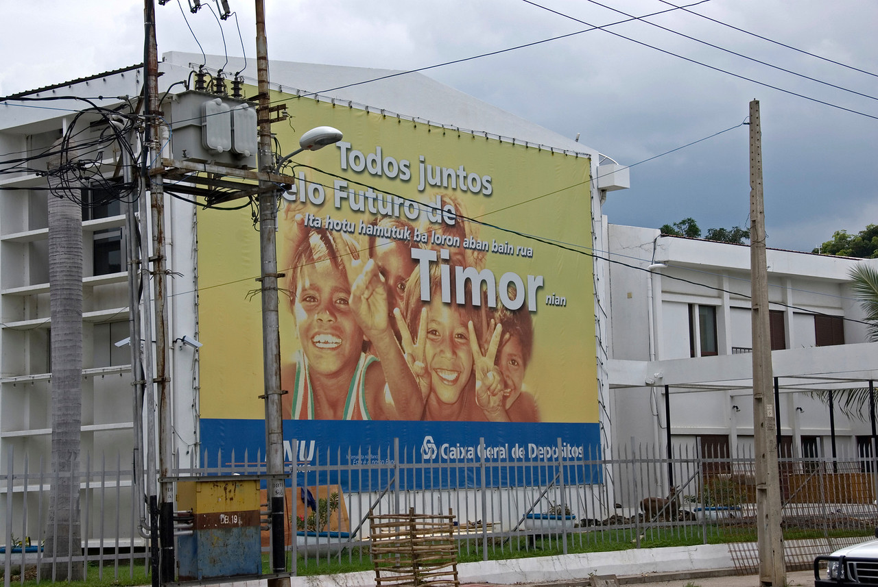 Local sign plastered on a building at Dili, East Timor