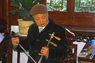 Playing String Bow - Wuxi