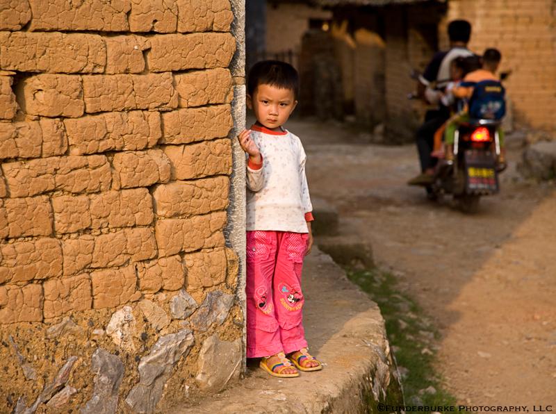 Child in village near Yangshuo - China