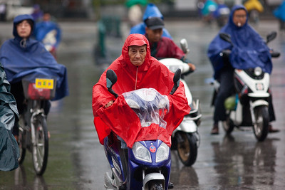 Shanghai, China - September 3, 2009: Bikers in the rain in downtown Shanghai. (Photo by: Christopher Herwig)