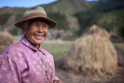 Xiahe, Gannan Tibetan Autonomous Prefecture, Gansu Province, China -  September 10, 2009:  Elderly tibetan woman farming outside Xiahe. Xiahe is home to the Labrang Monastery, one of largest Tibetan Monasteries outside of Tibet. (Photo by: Christopher Herwig)