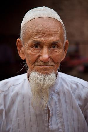 Tuyoq, Xinjiang, China - September 18,2009: Portrait of a senior Uyghur man in Tuyoq. (Photo by: Christopher Herwig)