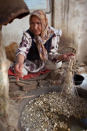 Hotan, Xinjiang, China - September 29, 2009: Traditional silk factory outside Hotan.  (Photo by: Christopher Herwig)