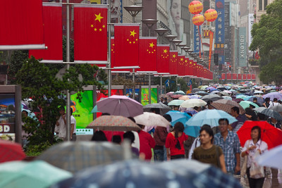 Shanghai, China - September 3, 2009: Row of Chinese flags down East Nanjing Road is the most polular shopping street in Shanghai and is partially blocked to traffic.  (Photo by: Christopher Herwig)