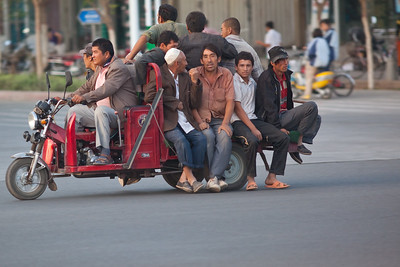 Motorbike with wagon being used as a taxi in Turpan, China.