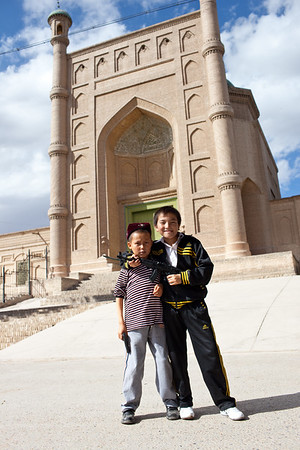 Kucha, China - September 23, 2009:  Young boys playing in the street in front of a mosque. (Photo by: Christopher Herwig)