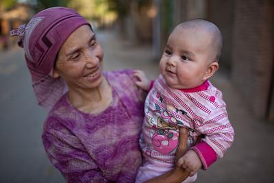 Grandmother and baby in Turpan, Xinjiang, China.