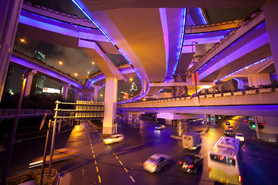 Shanghai, China - September 3, 2009: Neon lights and traffic from a web of overpasses and roads at the intersection of North Chengdu Road and Yan'an Road in downtown Shanghai.  (Photo by: Christopher Herwig)