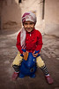 Kashgar, China - September 25, 2009: Portrait of a young girl playing in an alley in Kashgar's old town. (Photo by: Christopher Herwig)