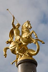 Tbilisi, Georgia - January, 2008: Large statue of St. George slaying the dragon in Tavisuplebis Moedani (Freedom Square) in the center of Tbilisi, Georgia. (Photo by Christopher Herwig)