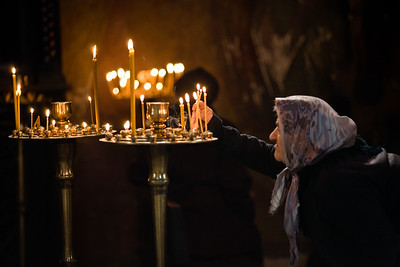 Tbilisi, Georgia - January, 2008: Senior Georgian woman lights a prayer candle in Sioni Cathedral in Tbilisi, Georgia where a church has been since the 6th century AD. (Photo by Christopher Herwig)