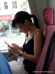 If it's not a phone, it's a Nintendo DS. No PSPs or iPods to be seen on Asia's public transport system.