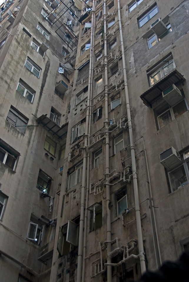 Looking up the tall Chungking Mansions building at Kowloon, Hong Kong