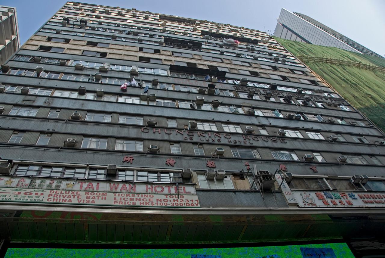 Looking up the Chungking Mansion facade in Kowloon, Hong Kong