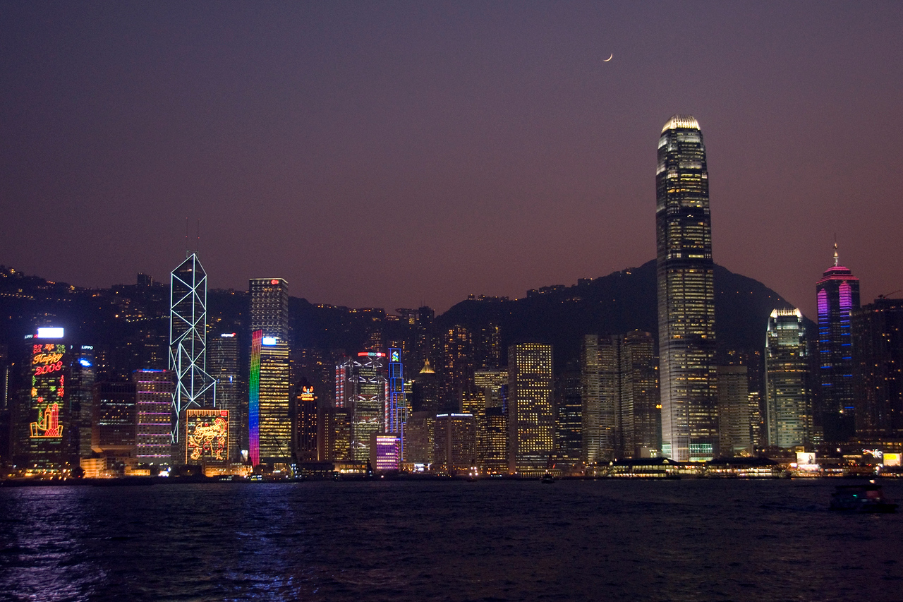 Bright and colorful city lights from Hong Kong skyline via the Victoria Harbor