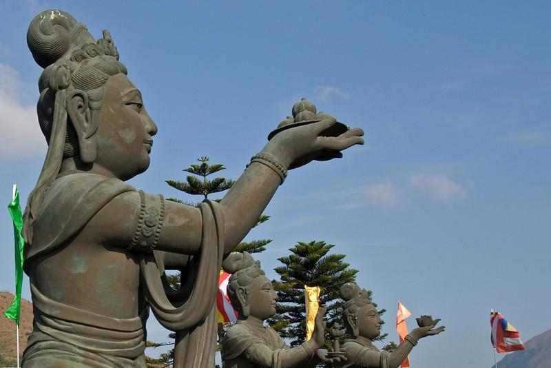 Row of Big Buddha statues at Po Lin Temple in Hong Kong
