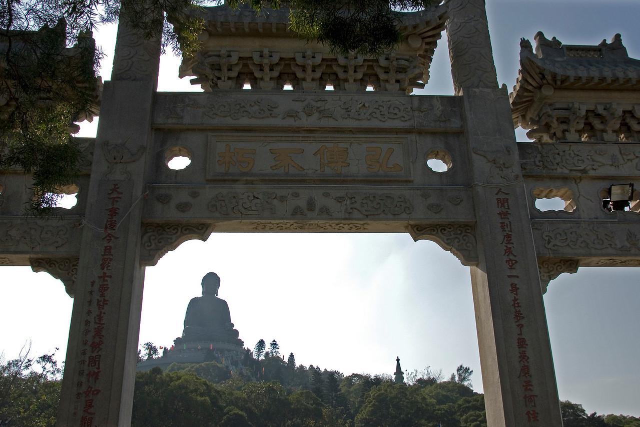 Tian Tan Buddha peeking out behind the gate in Hong Kong