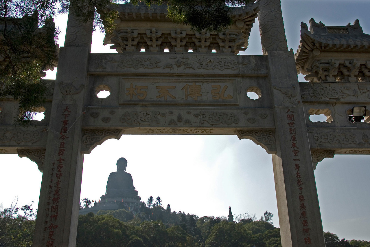 Tian Tan Buddha peeking out behind the gate in Hong Kong