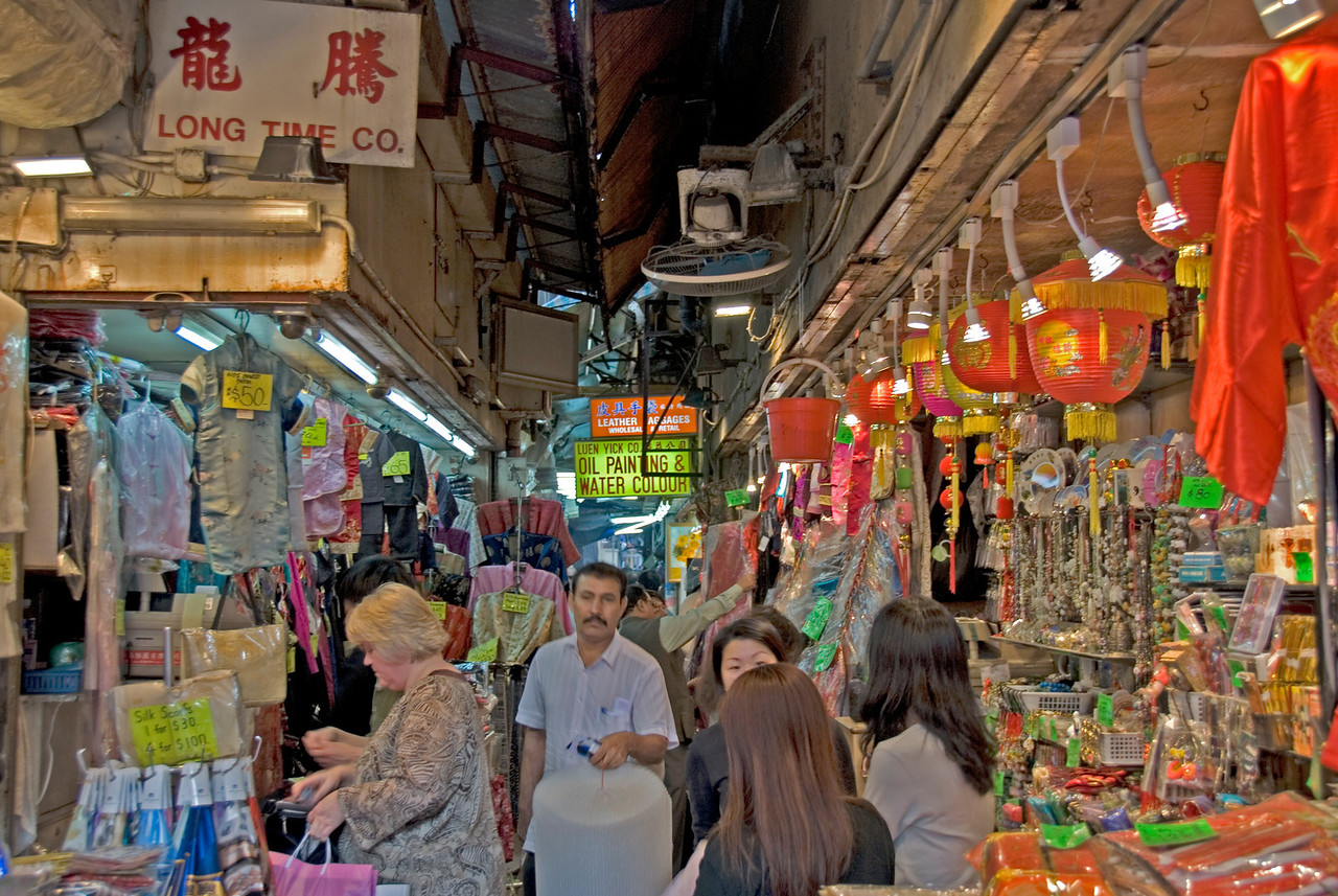 Locals and tourists shopping at the Chungking Alley market in Hong Kong