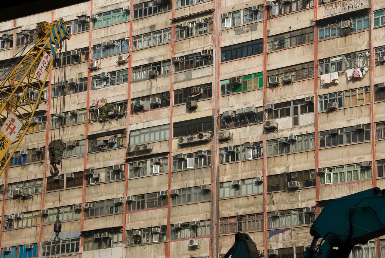 Windows at the facade of Chungking Mansions in Kowloon, Hong Kong