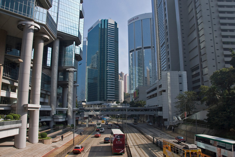 Busy street sandwiched by skyscrapers in the city of Hong Kong