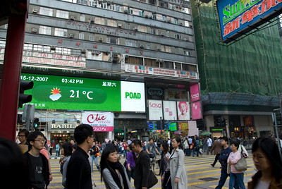 Local pedestrians near the Chungking Mansion building in Kowloon
