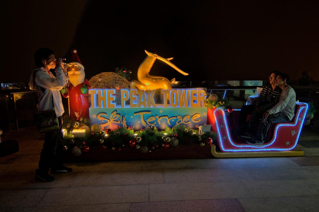 Tourists having their photo taken at The Peak Tower's Christmas display