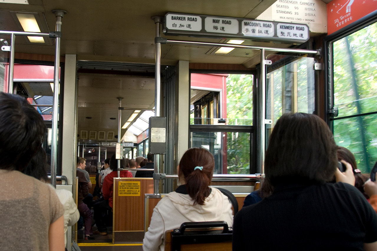 Locals and tourists inside the Peak Trolly in Hong Kong