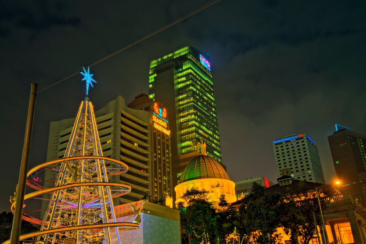Colorful Christmas tree and skyline at night in Hong Kong