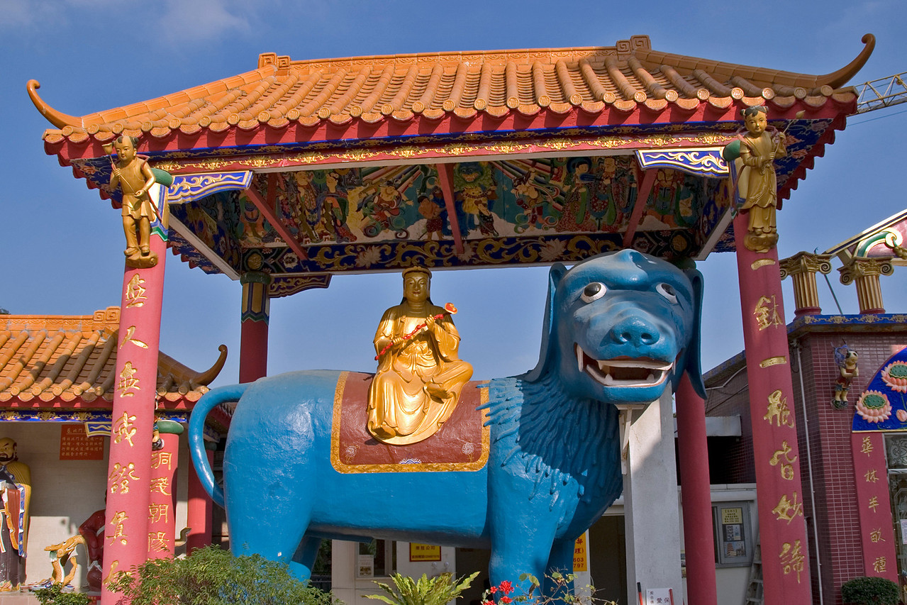 Buddha statue sitting on a big blue dog statue at 10,000 Buddhas Temple