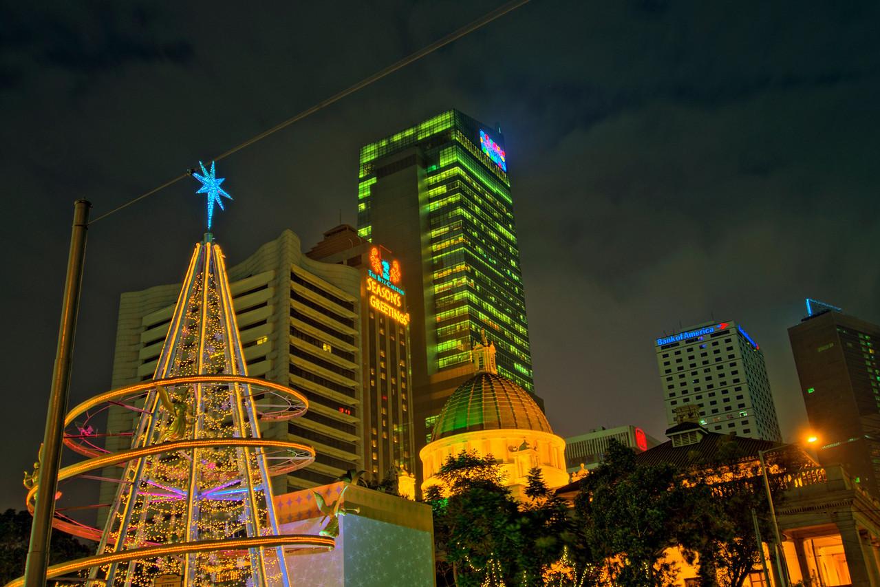 Christmas tree and bright lights at Hong Kong city skyline at night
