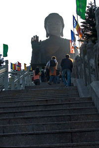 Tourists walking up the stairs to Big Buddha statue in Po Lin Temple
