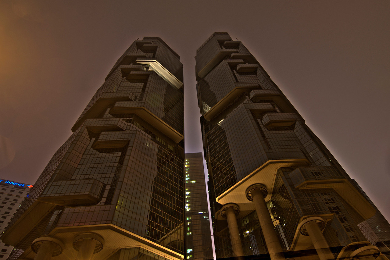 Looking up two adjacent skyscrapers in Hong Kong at night