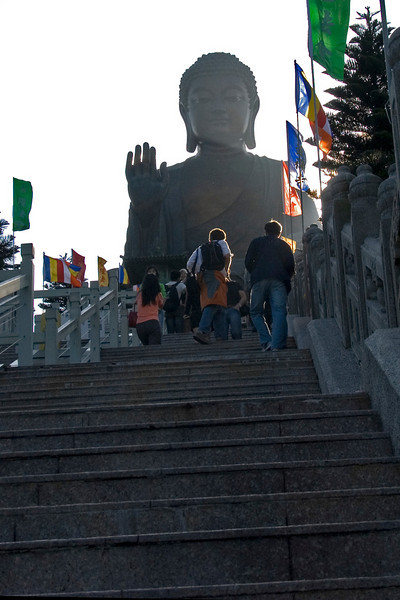 Tourists walking up the stairs towards Big Buddha in Po Lin Temple